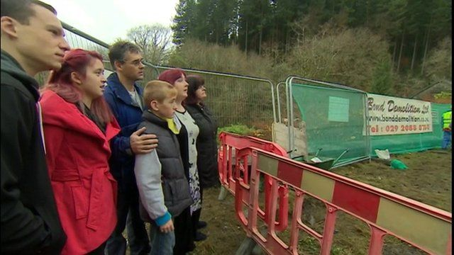 April Jones' family watches as the house is demolished
