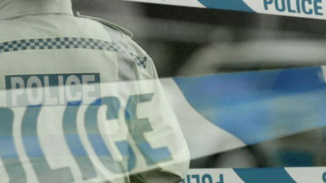 Image of policeman and tape