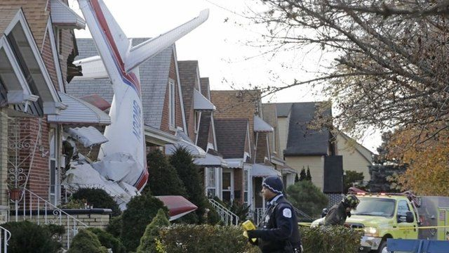 A small twin-engine cargo plane that crashed into a home on Chicago's southwest side