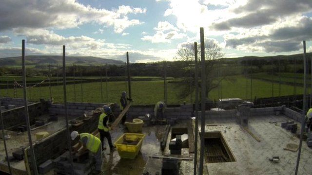 House builders on a rural construction site