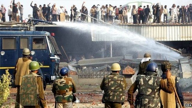 Police attempt to disperse Rampal's supporters with water cannons