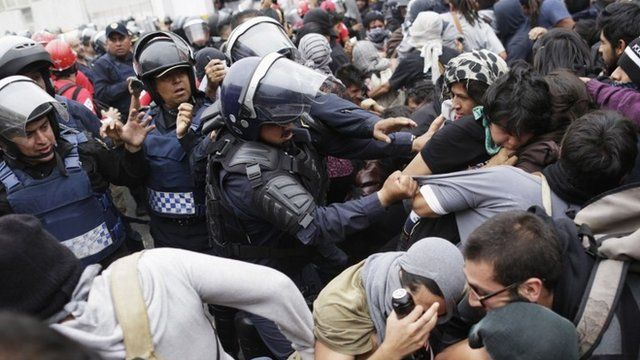 Riot police scuffle with demonstrators during a protest over the 43 missing Ayotzinapa students, near the Benito Juarez International airport in Mexico City 20 November, 2014