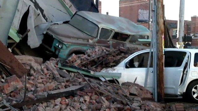 The building collapsed onto the woman's car following a car chase in Kansas  City