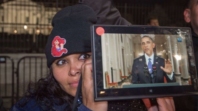 Woman watching Obama's speech live
