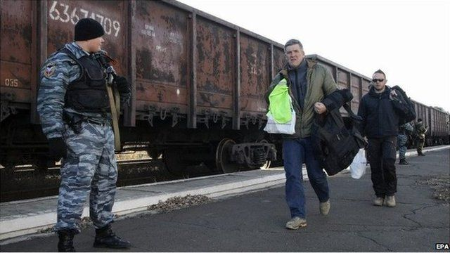 Freight train carrying parts of the wreckage the of Flight MH17 in the rebel-held city of Torez on 23 November 2014.