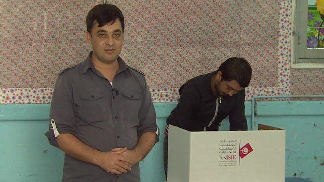 Mehrdad Farahmand in a polling station