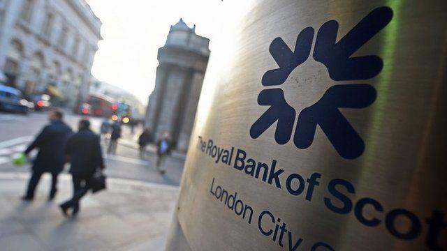 Pedestrians pass a Royal Bank of Scotland (RBS) bank branch