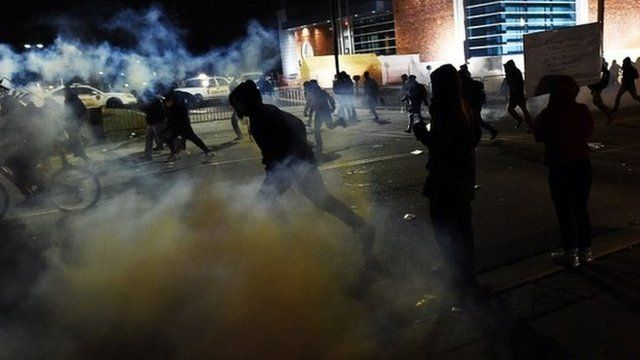 Demonstrators flee as police fire tear gas during clashes in Ferguson
