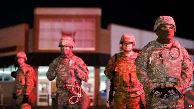 Missouri National Guard stand watch outside a store in Ferguson