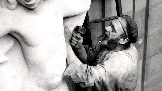 Eric Gill at work on the Prospero and Ariel sculpture outside the BBC's Broadcasting House in London