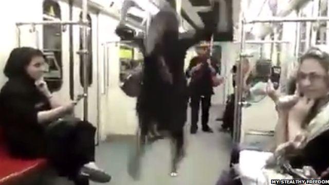 Woman dancing on Tehran Metro