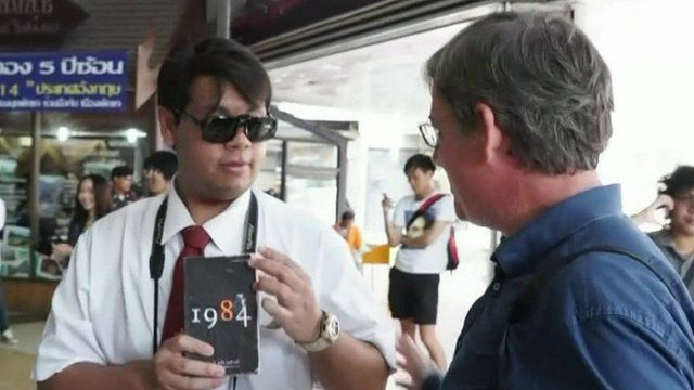 Activist with his copy of 1984