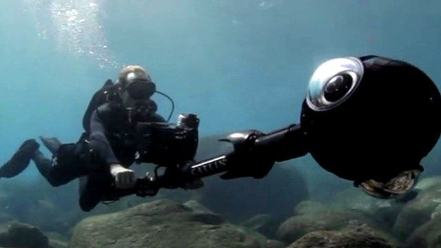 Diver with a camera mapping the ocean floor