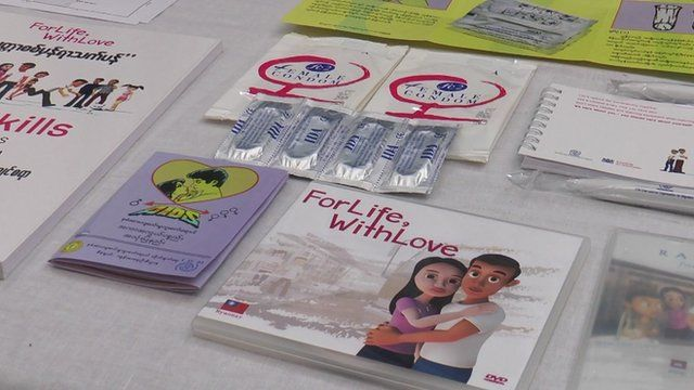 Collection of HIV AIDS awareness pamphlets and condoms