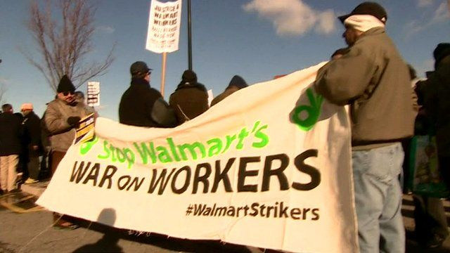 "Protesters hold a ""War on Workers"" banner during the Black Friday strike"