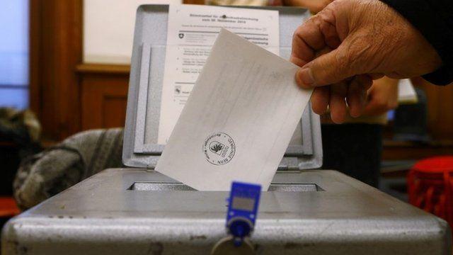 Man casts ballot in Bern