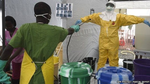 Health workers in protective clothing
