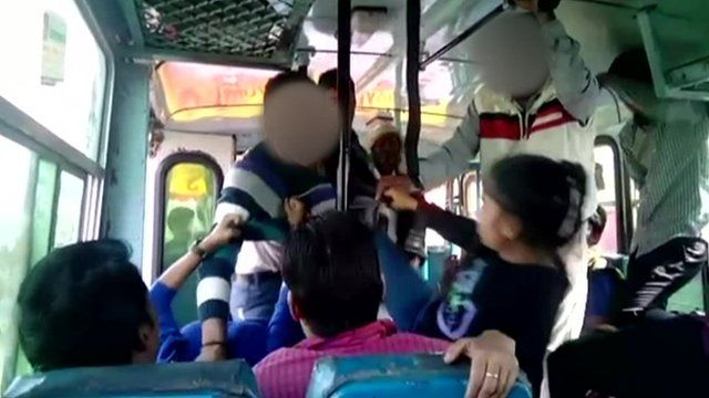 A girl kicks a man on a bus in India
