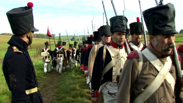 Waterloo re-enactment actors march in a line