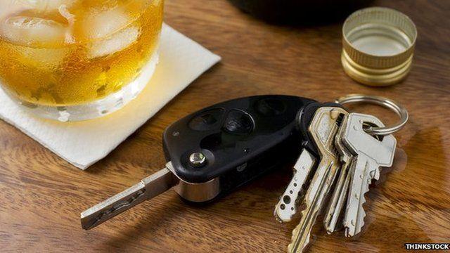 Car keys by a drink