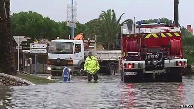 Emergency vehicles in flooded street in French town of Saint-Cyprien