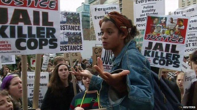 Girl addressing protesters at rally in New York City