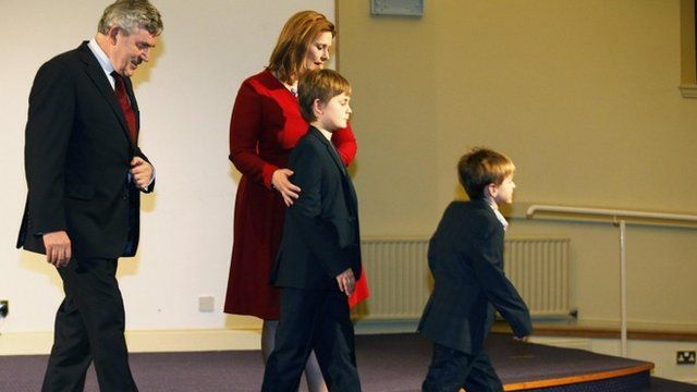 Former British Prime Minister Gordon Brown, his wife Sarah and children James and John