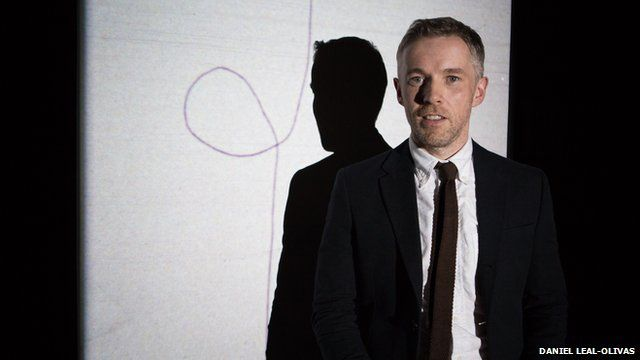 Turner prize-winner Duncan Campbell poses in front of his work