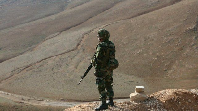 Lebanese soldier standing on hillside