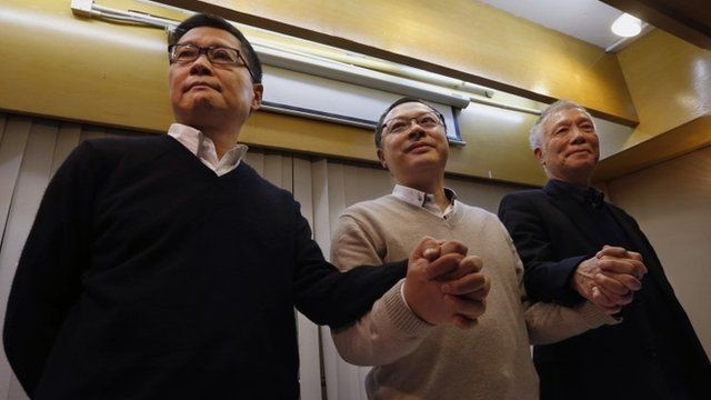 Occupy Central civil disobedience founder Benny Tai (C), with co-founders Chan Kin-man (L), and Reverend Chu Yiu-ming,