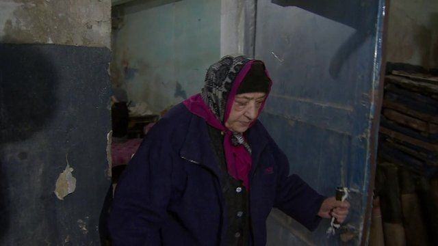 An old woman in a shelter in east Ukraine