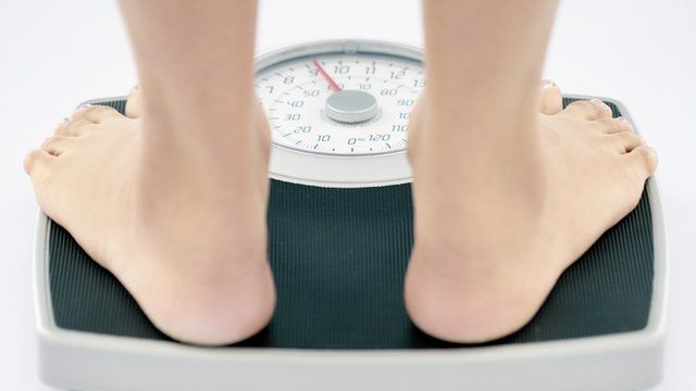 Some feet on a set of weighing scales