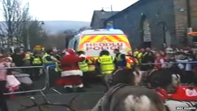 Santa leaves Christmas parade in the back of a police van in Aberdare, Cynon Valley