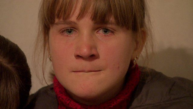 A crying girl in an underground shelter in Donetsk
