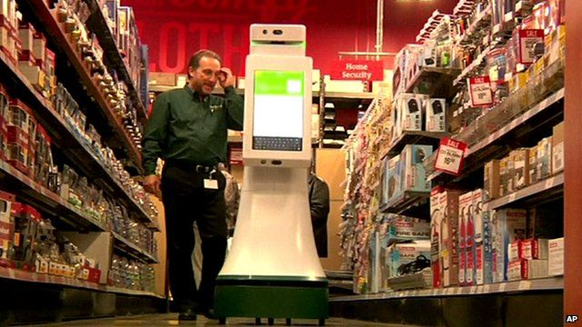 Wheeled robot assisting a shopper in a hardware store