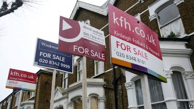 For Sale signs outside houses