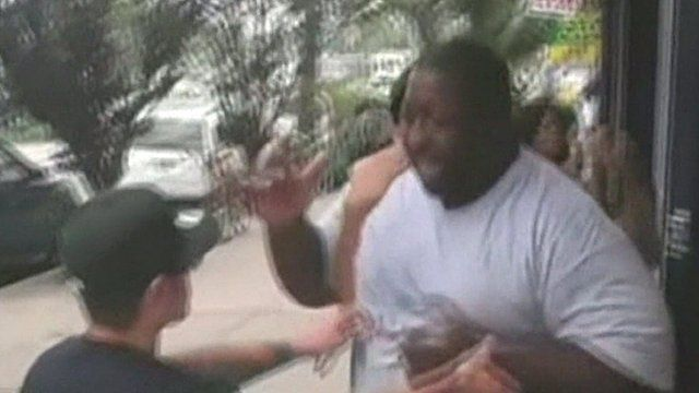 Still from video posted online of Eric Garner being confronted by police officers