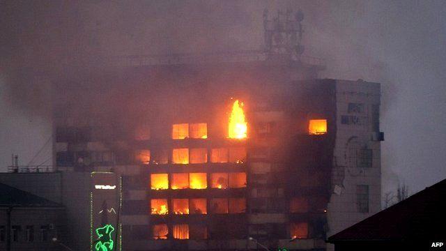 media building burns as militants attack in central Grozny