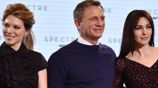 "British actor Daniel Craig (C), French actress Lea Seydoux (L) and Italian actress Monica Bellucci (R) pose during an event to launch the 24th James Bond film ""Spectre"""