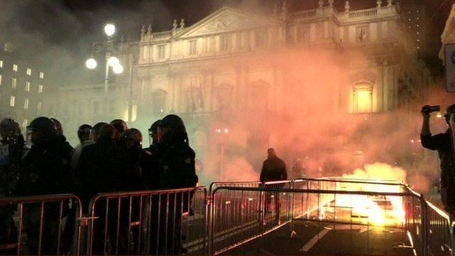 Protesters and police in Milan
