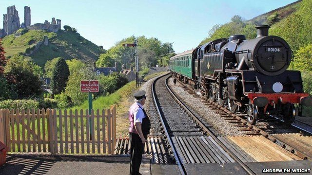 A steam train on the Swanage Railway line at Corfe Castle