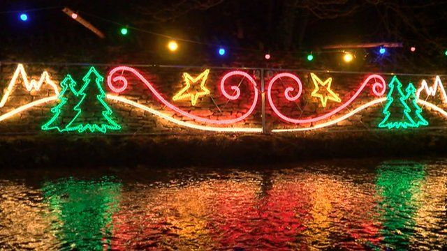 Christmas lights illuminating along Thornton le Dale's stream bank