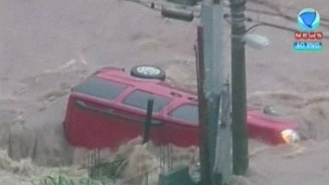A car is left stranded in the floodwater