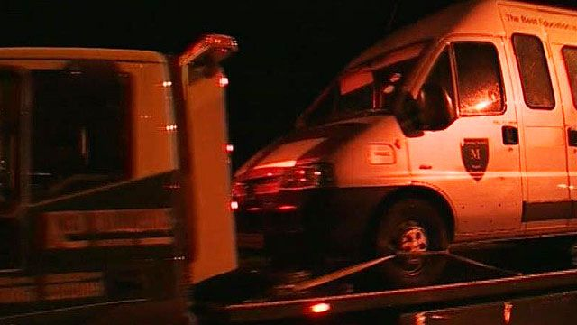 Minibus being taken away