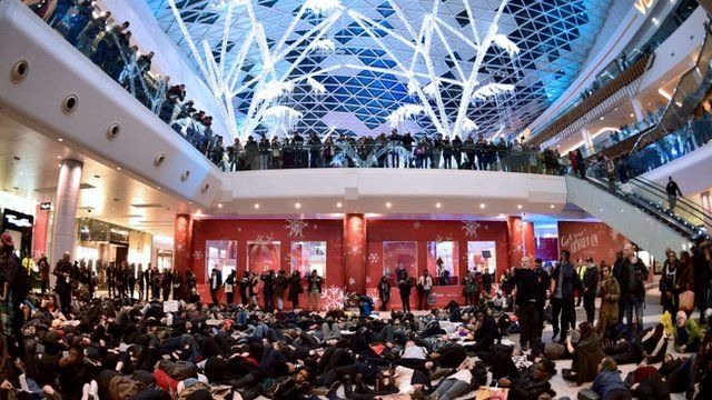 "A group of protesters create a ""die-in"" at the Westfield shopping mall in West London"