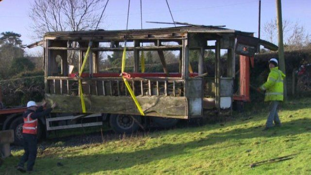 A team of workers used a digger to lift the tram from a field near Camlough, County Armagh