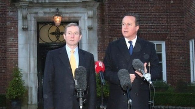 The British Prime Minister, David Cameron, right, and Irish Prime Minister, Enda Kenny, speak to the media at Stormont
