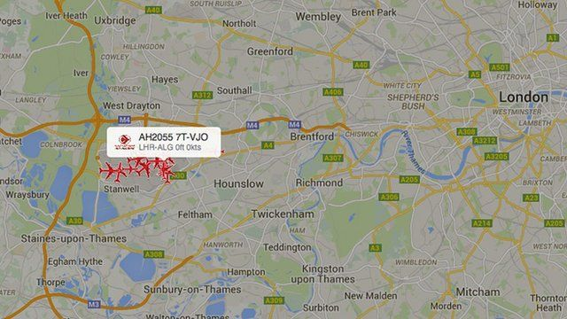Map of London showing aircraft icons over Heathrow area