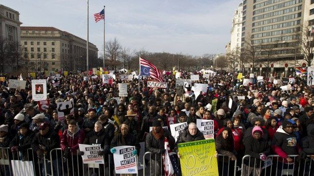 Protesters gather on Freedom Plaza for the march through Washington DC, 13 December