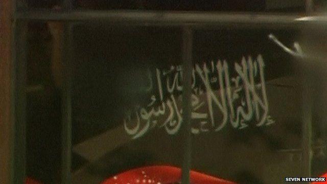 Close up of gunman's flag in Sydney cafe siege